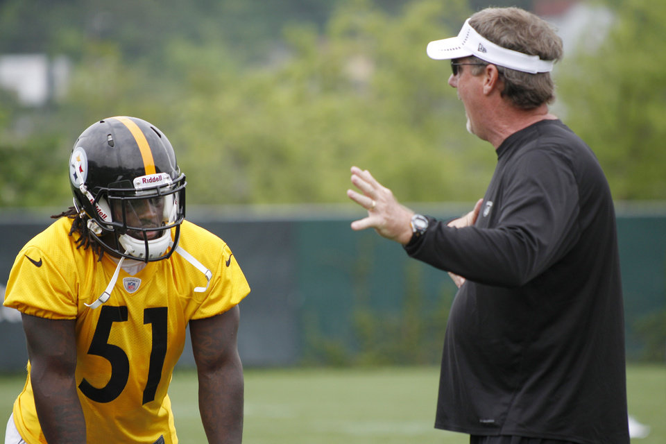 Pittsburgh Steelers third round draft pick, linebacker Sean Spence (51) , out of Miami, listens to linebacker coach Keith Butler during NFL football rookie minicamp at the team's training facility in Pittsburgh on Saturday, May 5, 2012. (AP Photo/Keith Srakocic)