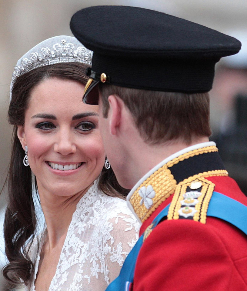 Photo - Kate, Duchess of Cambridge looks at her husband, Britain's Prince William, as they board the carriage following their wedding at London's Westminster Abbey, Friday Spril 29, 2011.(AP Photo/Lewis Whyld-pa)