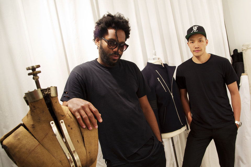 Photo - In this Thursday, May 22, 2014 photo, Dao-Yi Chow, right, and Maxwell Osborne, the designers behind Public School, pose for a portrait in their New York fashion studio. (AP Photo/Mark Lennihan)
