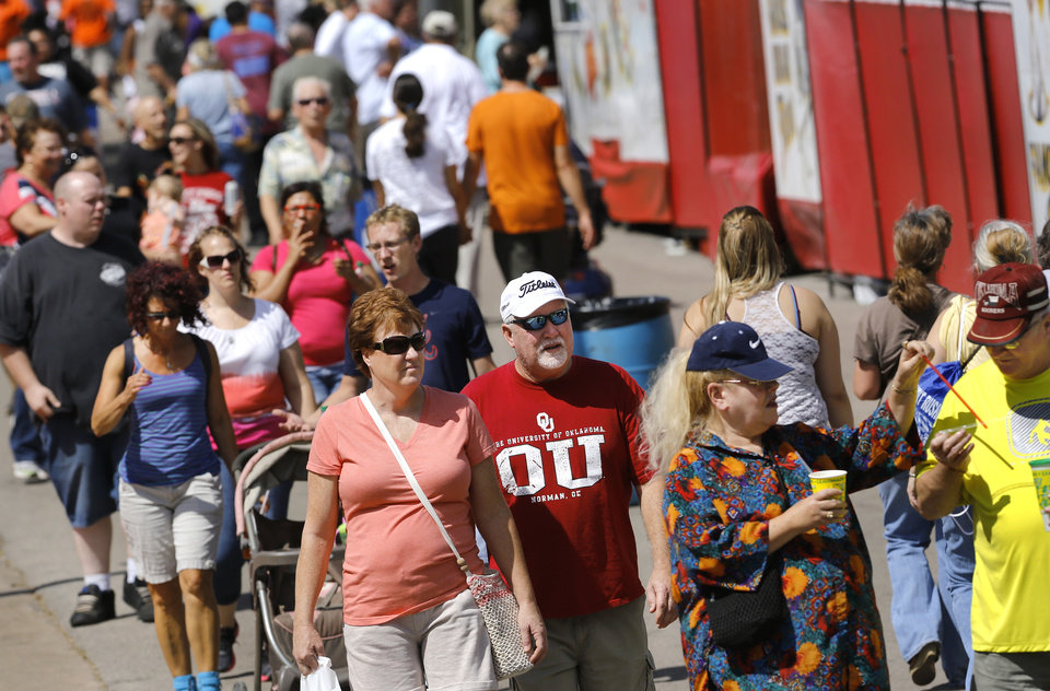 Photo - Visitors walk past food vendors at the Oklahoma State Fair on Wednesday, , Sep. 18, 2013. Photo  by Jim Beckel, The Oklahoman.