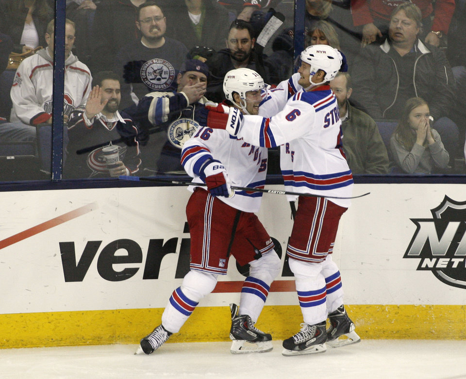 Photo - New York Rangers' Derick Brassard (16) celebrates his game-winning goal with teammate Anton Stralman (6), of Sweden, during the third period of an NHL hockey game against the Columbus Blue Jackets, Friday, March 21, 2014, in Columbus, Ohio. The Rangers won 3-1.  (AP Photo/Mike Munden)