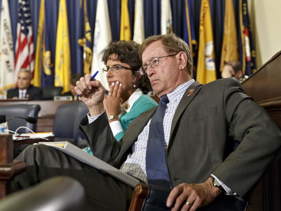 Photo - Rep. Paul Cook, R-Calif., right, and Rep. Jackie Walorski, R-Ind., members of the House Committee on Veterans' Affairs, listen as officials from the the Department of Veterans Affairs testify about allegations of gross mismanagement and misconduct at Veterans Administration hospitals, possibly leading to patient deaths, on Capitol Hill in Washington, Wednesday, May 28, 2014. (AP Photo/J. Scott Applewhite)