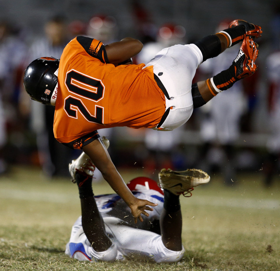 Photo - Chris Friday of Douglass is brought down runs against John Marshall during the  All-City Preview football scrimmages at Douglass High School in Oklahoma City, Friday, August 29, 2014. Photo by Bryan Terry, The Oklahoman