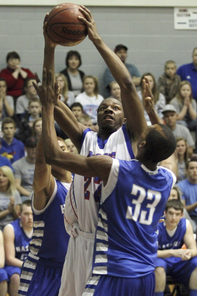 Millwood's Wayne Jackson shoots over Haskell's Michael Love during the Class 3A boys basketball game between Millwood and Haskell at Southern Nazarene University in Bethany Thursday, March 8th, 2012. PHOTO BY HUGH SCOTT, FOR THE OKLAHOMAN