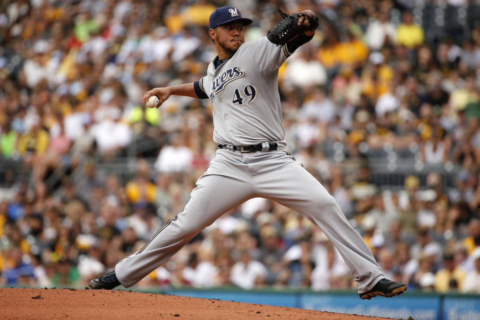 Photo - Milwaukee Brewers starting pitcher Yovani Gallardo (49) delivers during the first inning of a baseball game against the Pittsburgh Pirates in Pittsburgh Sunday, June 8, 2014. (AP Photo/Gene J. Puskar)