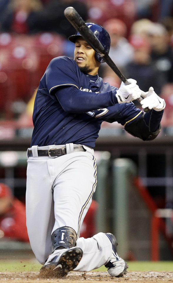 Photo - Milwaukee Brewers' Carlos Gomez tries to check his swing in the fifth inning of a baseball game against the Cincinnati Reds, Thursday, May 1, 2014, in Cincinnati. Gomez walked in the at bat. (AP Photo/Al Behrman)