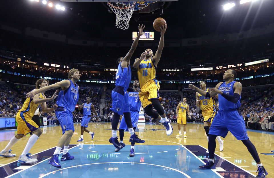 New Orleans Hornets guard Eric Gordon (10) drives to the basket against Dallas Mavericks' O.J. Mayo (32) in the first half of an NBA basketball game in New Orleans, Friday, Feb. 22, 2013. (AP Photo/Gerald Herbert)