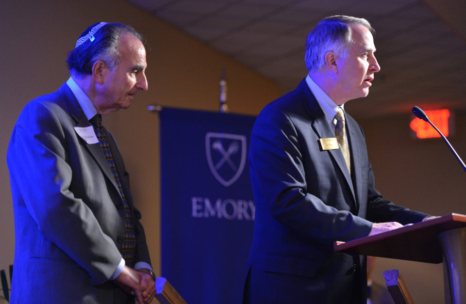 "James W. Wagner, right, president of Emory University, speaks as Perry Brickman stands after a film premiere documenting the period 1948-1961, when an abnormally high rate of failure for Jewish dental students at Emory pointed to a culture of anti-Semitism in one corner of the campus, at Emory University on Wednesday, Oct. 10, 2012. Emory University is apologizing for years of anti-Semitism at its dental school, when dozens of Jewish students were flunked out or forced to repeat courses. The documentary film ""From Silence to Recognition: Confronting Discrimination in Emory's Dental School History,"" by former dental student Perry Brickman, who was kicked out in 1952, featured interviews with dozens of men who had been affected by the school's anti-Semitism. (AP Photo/Atlanta Journal-Constitution, Hyosub Shin) MARIETTA DAILY OUT; GWINNETT DAILY POST OUT; LOCAL TV OUT; WXIA-TV OUT; WGCL-TV OUT"