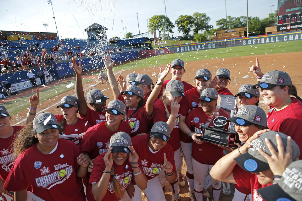 Photo - Oklahoma celebrates after winning the championship game of the Big 12 softball tournament between the University of Oklahoma (OU) and Baylor at ASA Hall of Fame stadium in Oklahoma City, Saturday, May 12, 2018. Photo by Bryan Terry, The Oklahoman