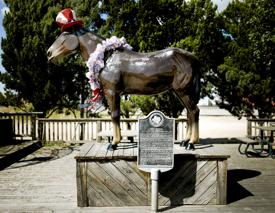 Photo - A sculpture of Old Pete stands at the National Mule Memorial in Muleshoe, Texas, hometown of Oklahoma's offensive coordinator Lincoln Riley, on Wednesday, June 24, 2015. Photo by Bryan Terry, The Oklahoman