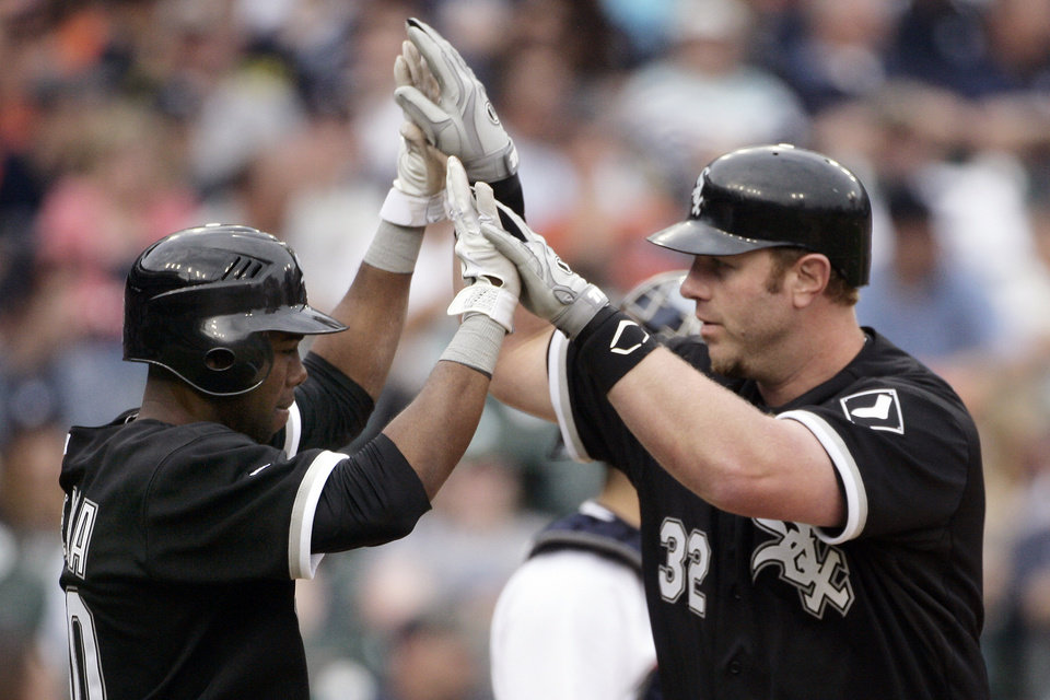 Chicago White Sox's Adam Dunn (32) celebrates with Alejandro De Aza after hitting a two-run home run in the ninth inning of a baseball game to defeat the Detroit Tigers 3-2, Saturday, May 5, 2012, in Detroit. (AP Photo/Duane Burleson)