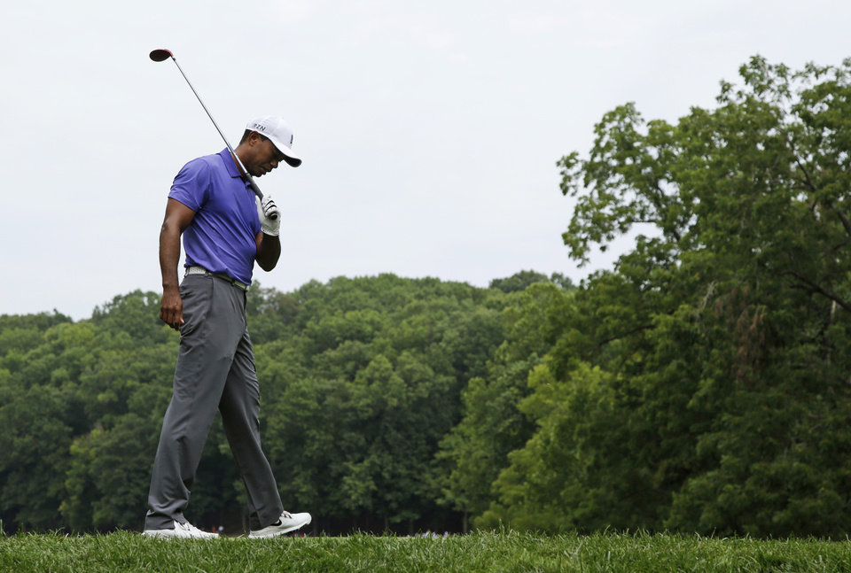 Photo - Tiger Woods react to a poor tee shot on the second hole during the first round of the PGA Championship golf tournament at Valhalla Golf Club on Thursday, Aug. 7, 2014, in Louisville, Ky. (AP Photo/John Locher)
