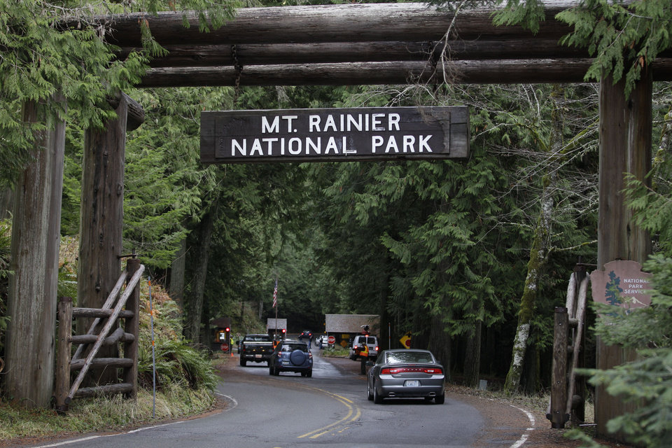 Photo -   FILE - The west entrance to Mount Rainier National Park is shown in this Jan. 1, 2012 file photo taken in Washington State. A Mount Rainier ranger slid more than 3,000 feet to his death Thursday June 21, 2012 as he helped in efforts to rescue four injured climbers who fell on a glacier, a National Park Service spokesman said. (AP Photo/Ted S. Warren, File)