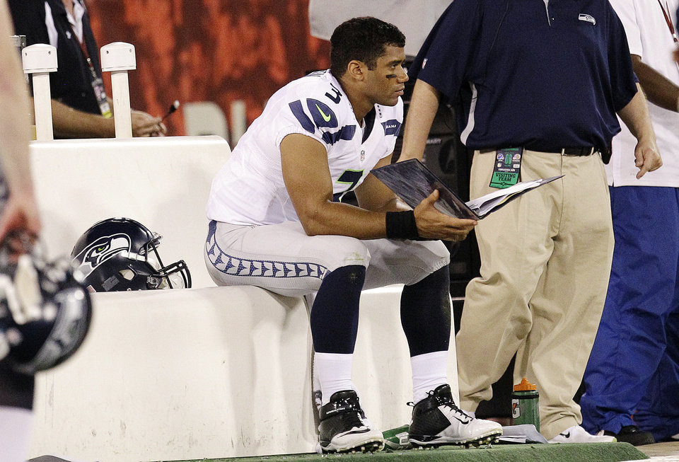 Photo -   Seattle Seahawks quarterback Russell Wilson (3) sits on the bench during the fourth quarter of an NFL football game against the San Francisco 49ers in San Francisco, Thursday, Oct. 18, 2012. The 49ers won 13-6. (AP Photo/Tony Avelar)