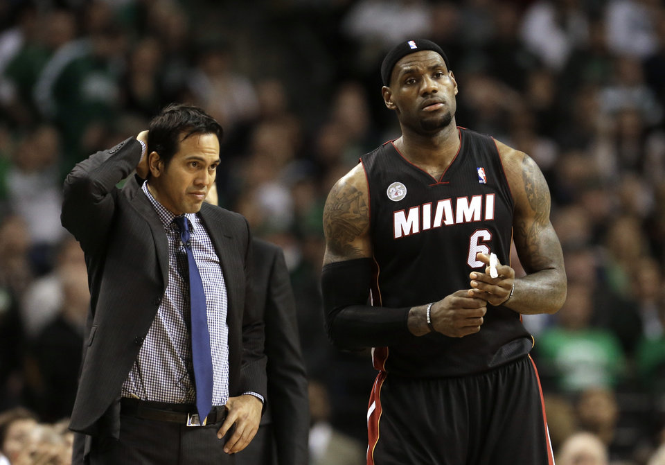 Miami Heat head coach Erik Spoelstra, left, and forward LeBron James (6), right, look on from the bench in the fourth quarter of an NBA basketball game against the Boston Celtics at the TD Garden in Boston, Sunday, Jan. 27, 2013. The Celtics won 100-98. (AP Photo/Steven Senne)