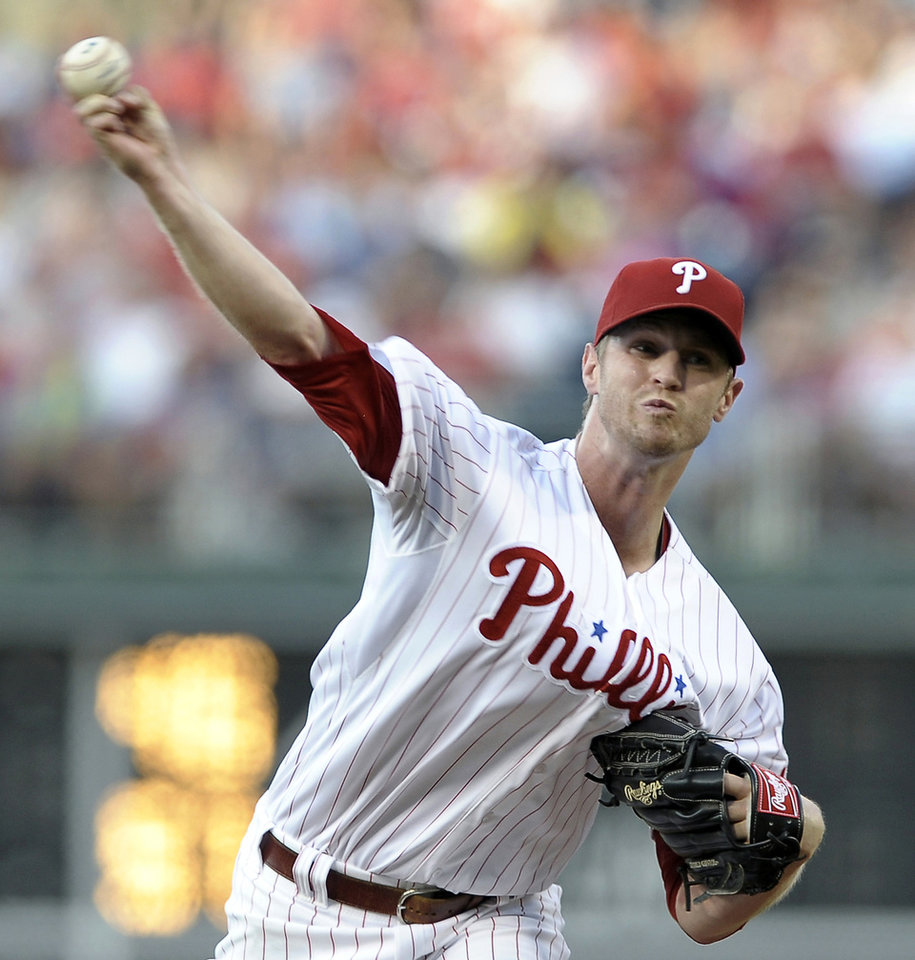 Photo - Philadelphia Phillies' Kyle Kendrick throws a pitch in the first inning of a baseball game against the Atlanta Braves on Saturday, July 6, 2013, in Philadelphia. (AP Photo/Michael Perez)