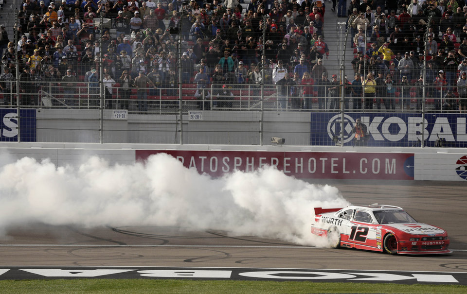 Sam Hornish Jr. does a burnout after winning the NASCAR Nationwide Series auto race, Saturday, March 9, 2013, in Las Vegas. (AP Photo/Julie Jacobson)