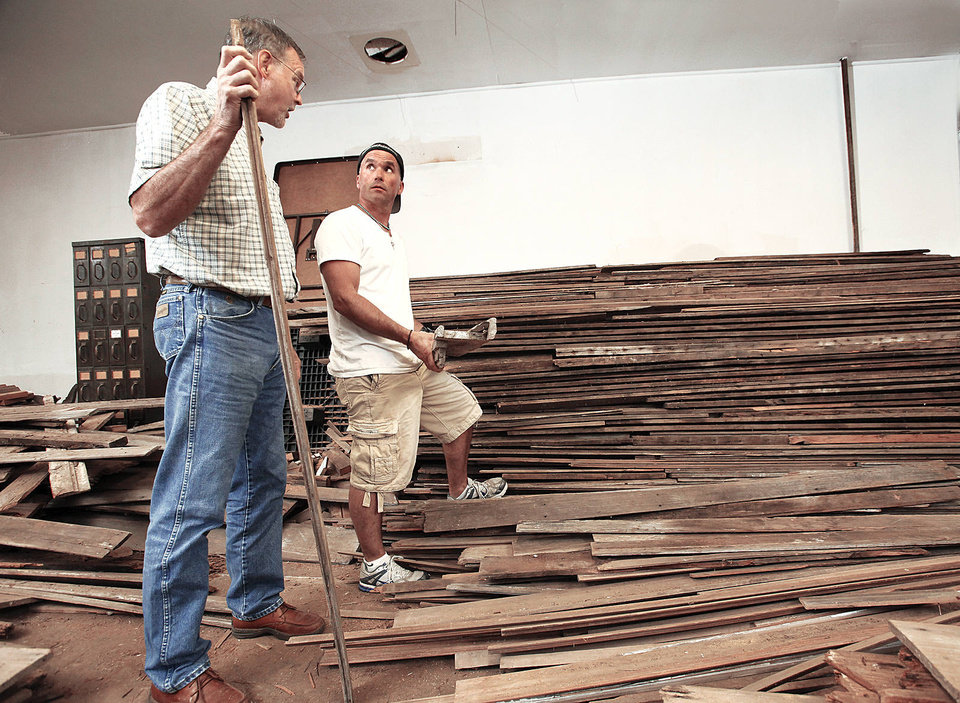 Photo - Wayland Bishop, left, and Dan Riedemann among the old boards that will be used to reconstruct the Woody Guthrie