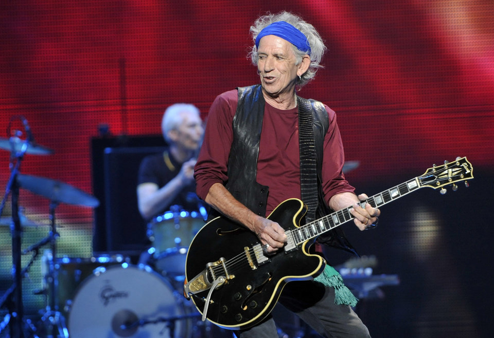 Photo - Keith Richards of the Rolling Stones performs on the kick-off of the band's