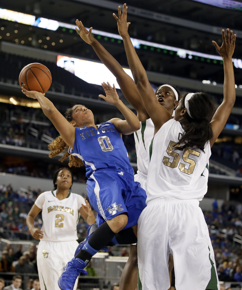 Kentucky's Jennifer O'Neill (0) goes up for a shot-attempt against Baylor's Khadijiah Cave (55) and Sune Agbuke, rear, as Niya Johnson (2) watches in overtime of an NCAA college basketball game, Friday, Dec. 6, 2013, in Arlington, Texas. O'Neill led her team in scoring with 43-points in the 133-130 four-overtime win over Baylor. (AP Photo/Tony Gutierrez)