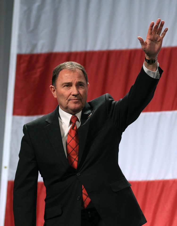 Photo - Utah Gov. Gary Herbert addresses a crowd during a rally at the Western Republican Leadership Conference, Friday, April 25, 2014, in Sandy, Utah. Republican U.S. Sen. Ted Cruz, of Texas, is scheduled to headline the final day of a two-day conference in Utah where Republican party leaders from western states are meeting. (AP Photo/Rick Bowmer)