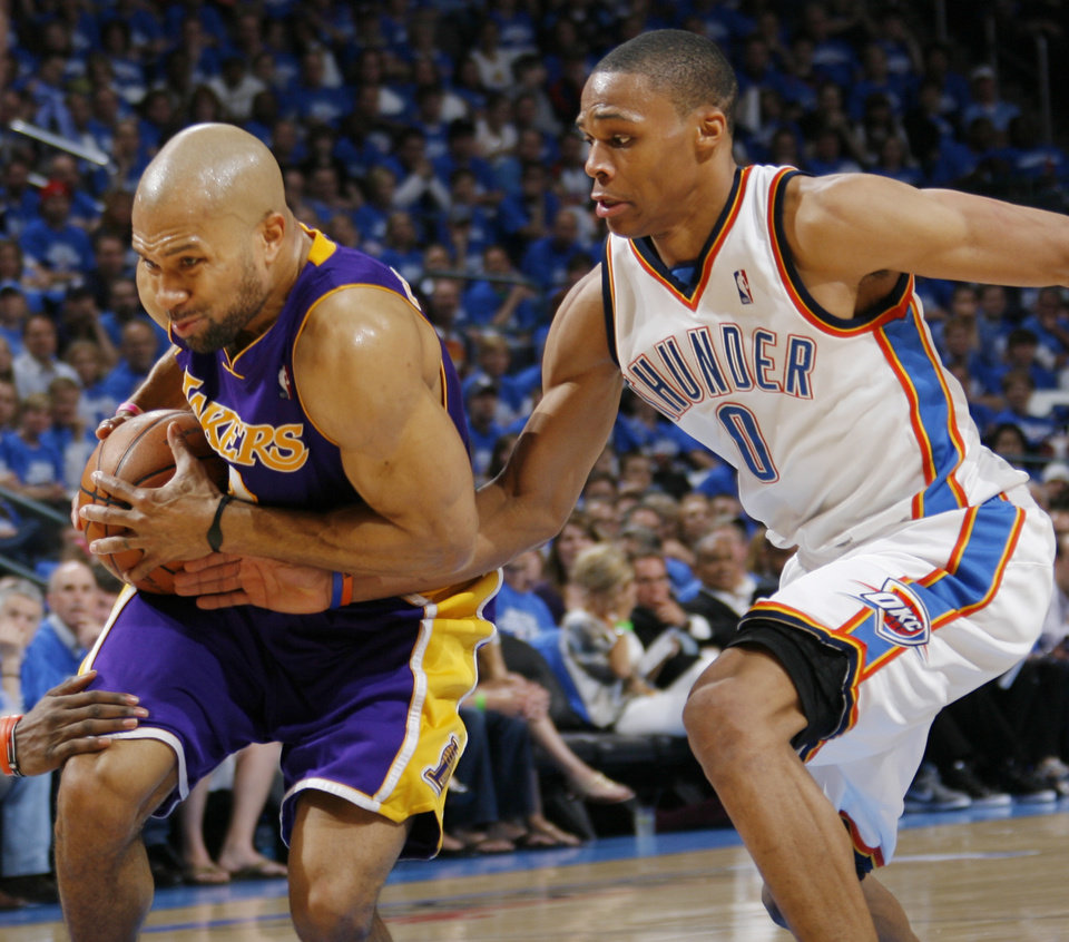 GAME THREE / L.A. LAKERS: L.A.'s Derek Fisher (2) tries to get past Russell Westbrook (0) of Oklahoma City during the NBA basketball game between the Los Angeles Lakers and the Oklahoma City Thunder in the first round of the NBA playoffs at the Ford Center in Oklahoma City, Thursday, April 22, 2010. Oklahoma City won, 101-96. Photo by Nate Billings, The Oklahoman ORG XMIT: KOD