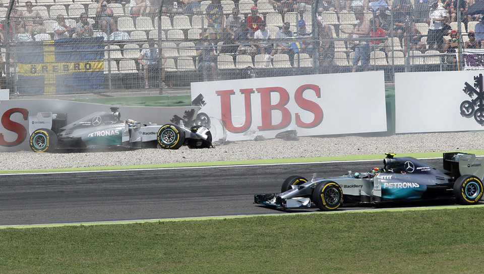 Photo - Mercedes driver Lewis Hamilton of Britain has crashed as Mercedes driver Nico Rosberg of Germany drives by during the qualifying of the German Formula One Grand Prix in Hockenheim, Germany, Saturday, July 19, 2014. The German Grand Prix will be held on Sunday.(AP Photo/Michael Probst)