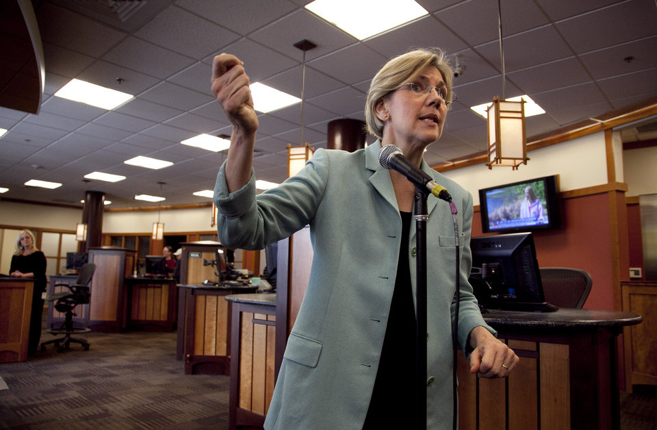 Photo -   Democratic candidate for the U.S. Senate Elizabeth Warren faces reporters during a news conference at Liberty Bay Credit Union headquarters, in Braintree, Mass., Wednesday, May 2, 2012. Warren responded to questions from reporters on her Native American heritage. (AP Photo/Steven Senne)