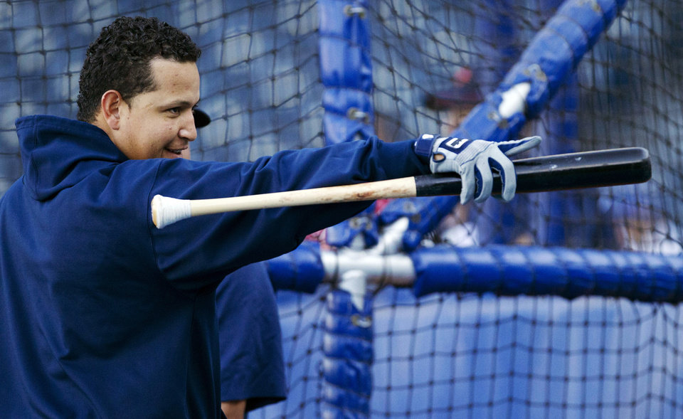 Photo -   Detroit Tigers' Miguel Cabrera points to fans during batting practice before a baseball game with the Kansas City Royals at Kauffman Stadium in Kansas City, Mo., Wednesday, Oct. 3, 2012. (AP Photo/Orlin Wagner)