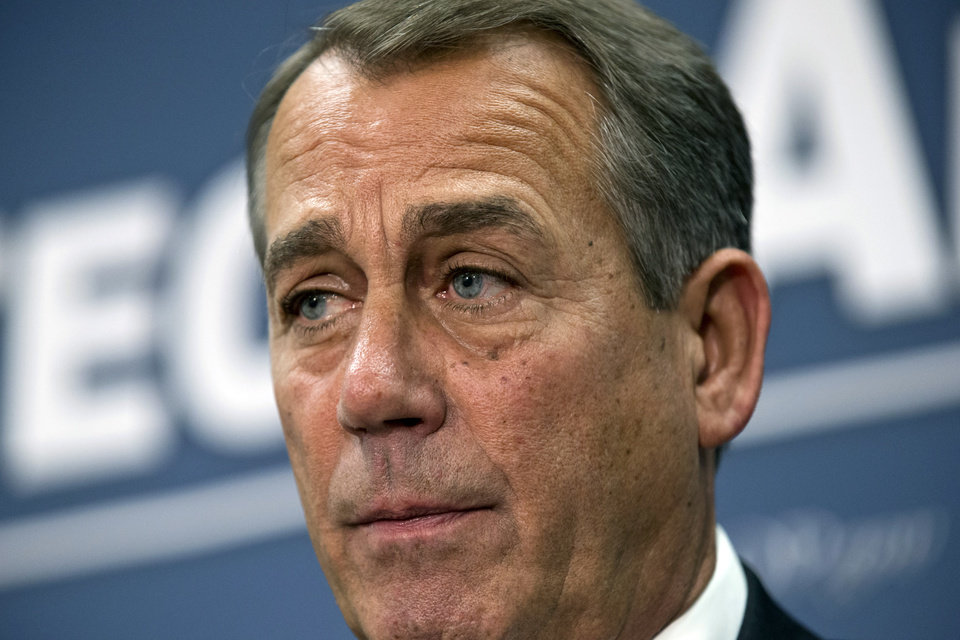 Photo - Speaker of the House John Boehner, R-Ohio, joined by the Republican leadership, speaks to reporters about the fiscal cliff negotiations with President Obama following a closed-door strategy session, at the Capitol in Washington, Tuesday, Dec. 18, 2012.  (AP Photo/J. Scott Applewhite)
