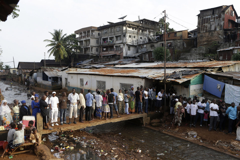 Photo -   Voters wait in line to cast their ballots in presidential, parliamentary, and local elections, outside a polling station in the Kroo Bay neighborhood of Freetown, Sierra Leone, Saturday, Nov. 17, 2012. A decade after Sierra Leone's brutal civil war, voters on Saturday chose between an incumbent president who has provided new roads and free health care and a field of opposition candidates who decry the poverty and pace of economic recovery.(AP Photo/Rebecca Blackwell)