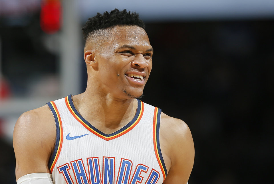 Photo - Oklahoma City's Russell Westbrook (0) smiles after an assist during an NBA basketball game between the Oklahoma City Thunder and the Memphis Grizzlies at Chesapeake Energy Arena in Oklahoma City, Thursday, Feb. 7, 2019. Photo by Bryan Terry, The Oklahoman
