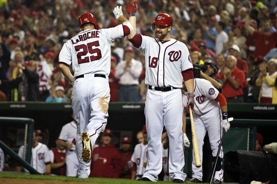 Photo -   Washington Nationals' Adam LaRoche (25) is congratulated by Chad Tracy (18) after hitting a home run during the sixth inning of a baseball game against the Philadelphia Phillies in Washington, Tuesday, Oct. 2, 2012. The Nationals won 4-2. (AP Photo/Manuel Balce Ceneta)