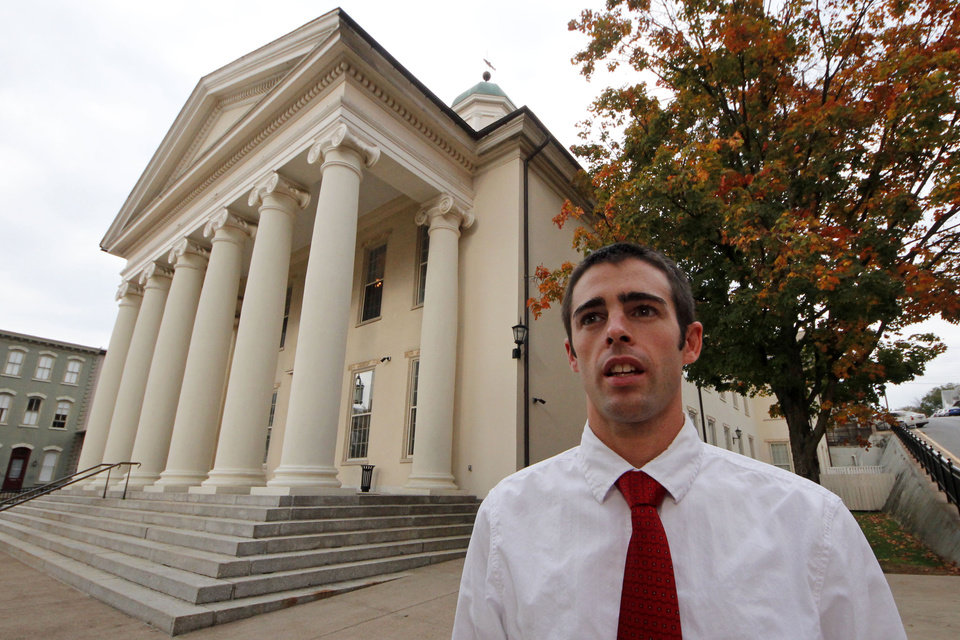 Photo -   Joshua Harper, of State College, Pa., a member of the Jerry Sandusky jury, stands in front of the Centre County Courthouse in Bellefonte, Pa., on Friday, Oct. 5, 2012. Harper, who has bachelor's and master's degrees from Penn State, said that he takes pride in having served on the jury, and that the guilty verdict was not a close call. He wants Sandusky
