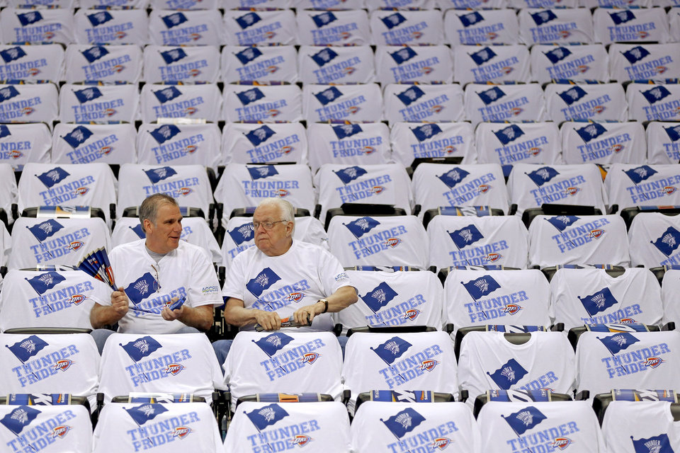 Ed Lotz, left, and Henry Primeaux of Tulsa wait for the start of Game 5 in the second round of the NBA playoffs between the Oklahoma City Thunder and the Memphis Grizzlies at Chesapeake Energy Arena in Oklahoma City, Wednesday, May 15, 2013.  Photo by Bryan Terry, The Oklahoman