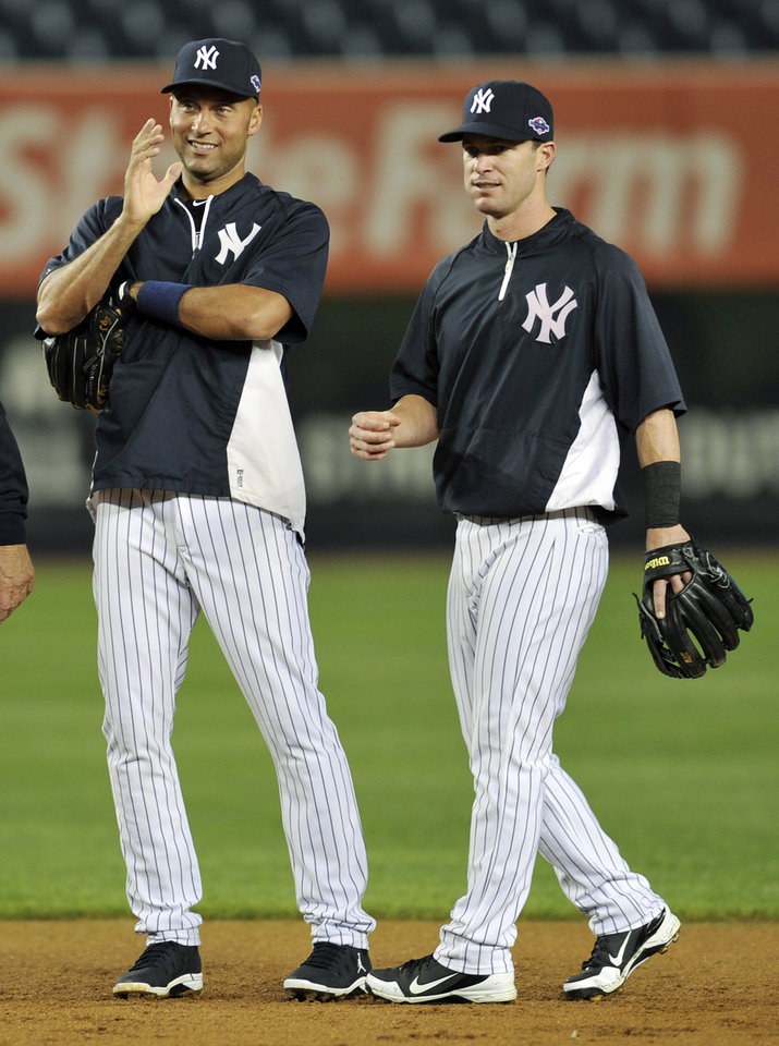 New York Yankees' Derek Jeter, left, talks with Jayson Nix during baseball practice Friday, Oct. 5, 2012, at Yankee Stadium in New York for an American League division series. (AP Photo/Bill Kostroun)