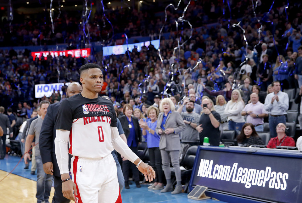 Photo - Houston's Russell Westbrook (0) walks to greet Oklahoma City Thunder players following the NBA basketball game between the Oklahoma City Thunder and the Houston Rockets at the Chesapeake Energy Arena in Oklahoma City,  Thursday, Jan. 9, 2020.  [Sarah Phipps/The Oklahoman]