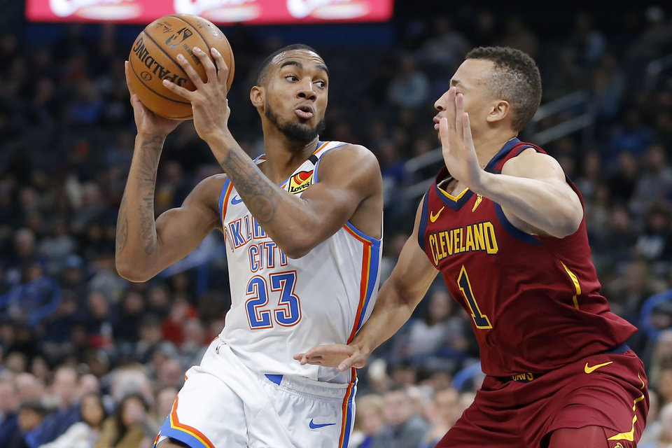 Photo - Oklahoma City's Terrance Ferguson (23) goes past Cleveland's Dante Exum (1) during an NBA basketball game between the Oklahoma City Thunder and the Cleveland Cavaliers at Chesapeake Energy Arena in Oklahoma City, Wednesday, Feb. 5, 2020. [Bryan Terry/The Oklahoman]