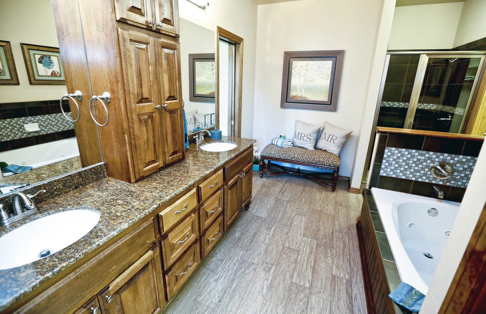 Photo - This view shows the master bath of the Raywood Homes House of Hope fundraiser house in Yukon.  CHRIS LANDSBERGER - The Oklahoman