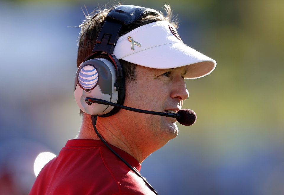 Oklahoma coach Bob Stoops watches during the college football game between the University of Oklahoma Sooners (OU) and the University of Kansas Jayhawks (KU) at Memorial Stadium in Lawrence, Kan., Saturday, Oct. 19, 2013. Oklahoma won 34-19. Photo by Bryan Terry, The Oklahoman