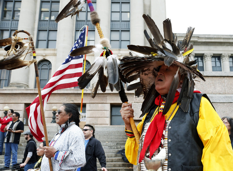 Photo - Rodney Factor, left, of Seminole, Okla., and Burt Poor Buffalo, right, of Pink, Okla., participate in an Indigenous Rights protest at the state Capitol in Oklahoma City, Thursday, Jan. 24, 2013. (AP Photo/Sue Ogrocki) ORG XMIT: OKSO102