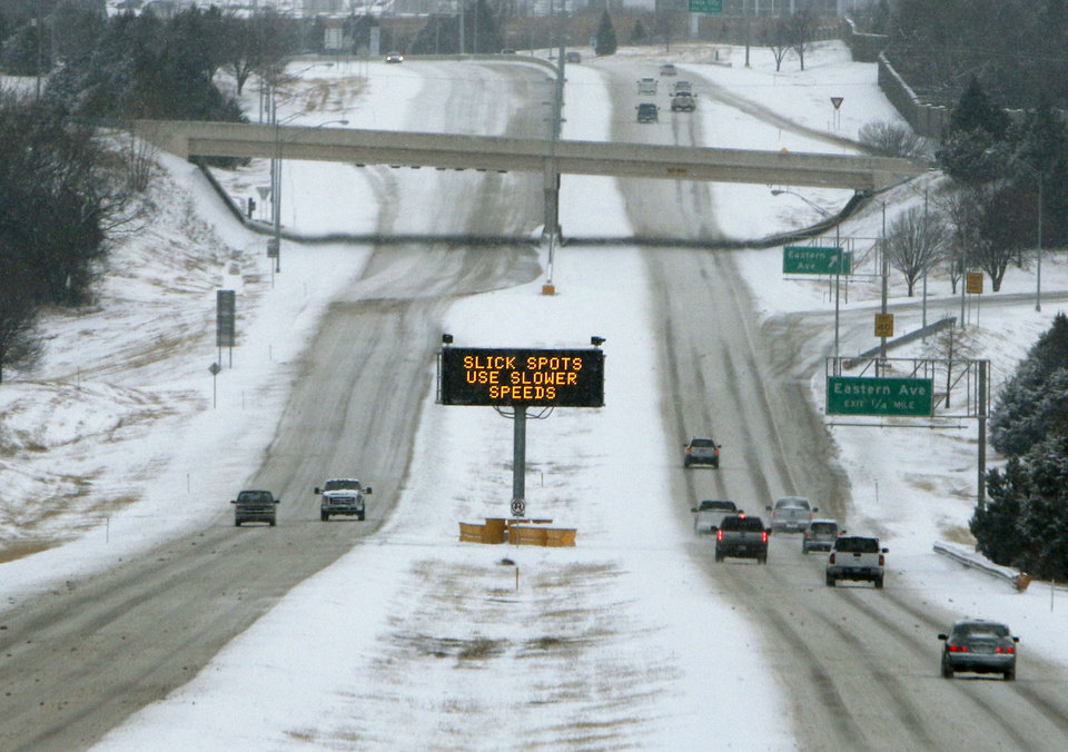 A lighted sign warns drivers of road conditions on the Kilpatrick Turnpike in Oklahoma City, OK, Friday, December 6, 2013,  Photo by Paul Hellstern, The Oklahoman