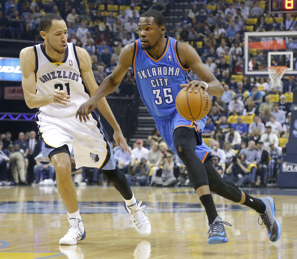 Oklahoma City's Kevin Durant (35) drives up court as Memphis' Tayshaun Prince (21) defends during Game 6  in the first round of the NBA playoffs between the Oklahoma City Thunder and the Memphis Grizzlies at FedExForum in Memphis, Tenn., Thursday, May 1, 2014. Photo by Bryan Terry, The Oklahoman