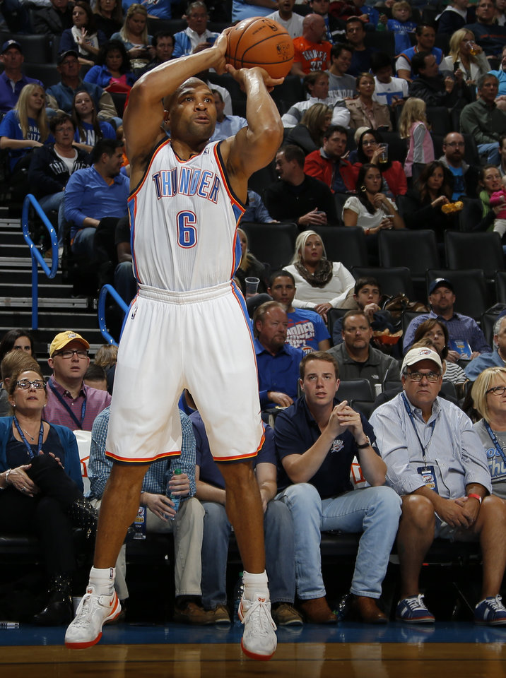 Photo - Oklahoma City 's Derek Fisher (6) shoots a basket during an NBA preseason game between the Oklahoma City Thunder and the Denver Nuggets at Chesapeake Energy Arena on Tuesday, october 15, 2013. Tuesday, Oct. 15, 2013. Photo by Bryan Terry, The Oklahoman