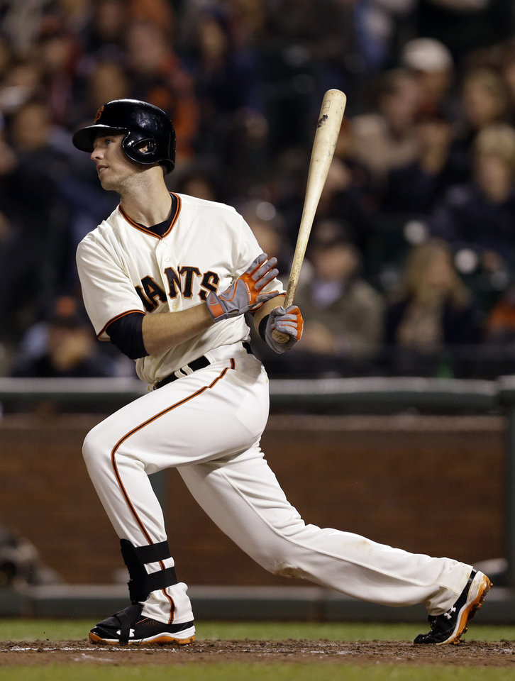 In this Sept. 25, 2012, photo, San Francisco Giants' Buster Posey bats against the Arizona Diamondbacks during a baseball game in San Francisco. Posey agreed to an $8 million, one-year contract with the Giants on Friday, Jan. 18, 2013. (AP Photo/Marcio Jose Sanchez)