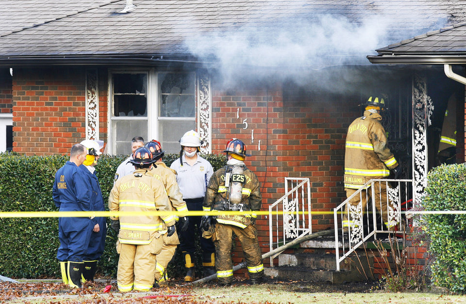 Oklahoma City firefighters and police investigate a house fire at 1511 SW 56 in Oklahoma City on Monday morning. PHOTO BY PAUL B. SOUTHERLAND, THE OKLAHOMAN