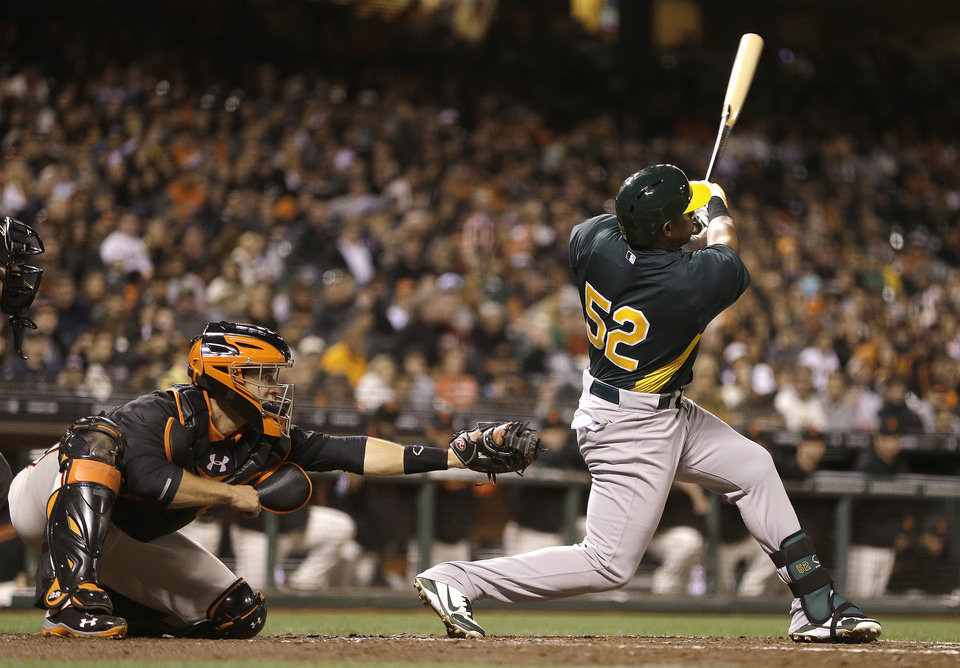 Oakland Athletics' Yoenis Cespedes swings for a two-run home run off San Francisco Giants' Tim Lincecum in the fourth inning of an exhibition baseball game Thursday, March 28, 2013, in San Francisco. (AP Photo/Ben Margot)