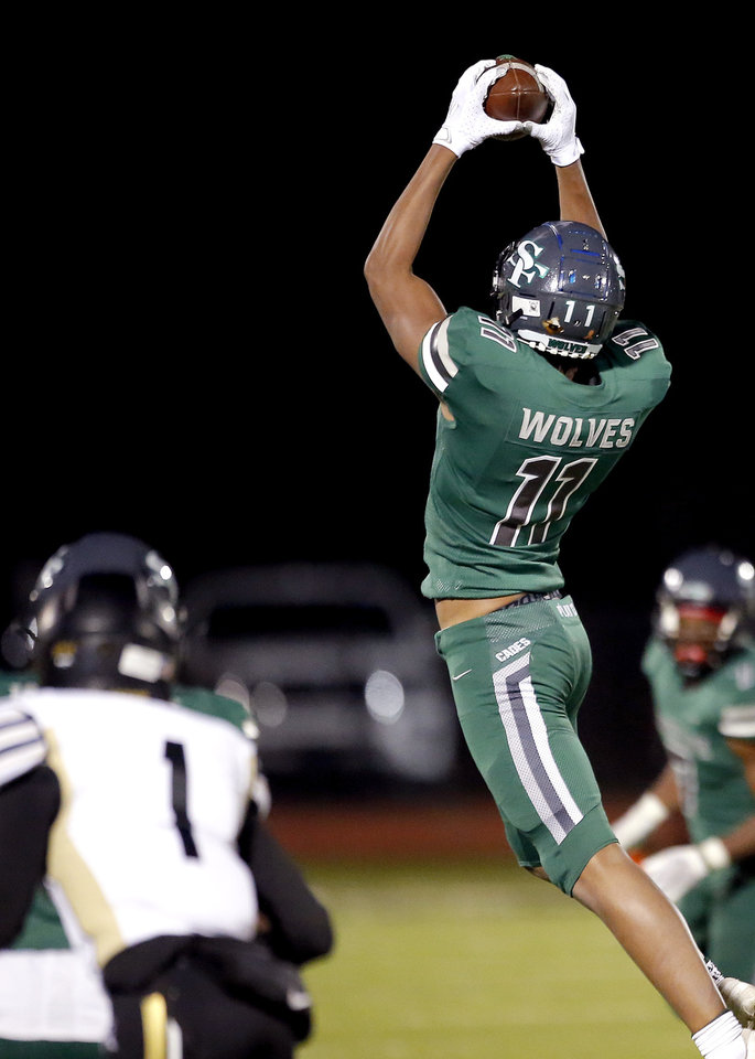 Photo - Edmond Santa Fe's Tabry Shettron makes a reception during the high school football game between Edmond Santa Fe and Broken Arrow at Edmond Santa Fe in Edmond, Okla., Friday, Oct. 23, 2020. Photo by Sarah Phipps, The Oklahoman