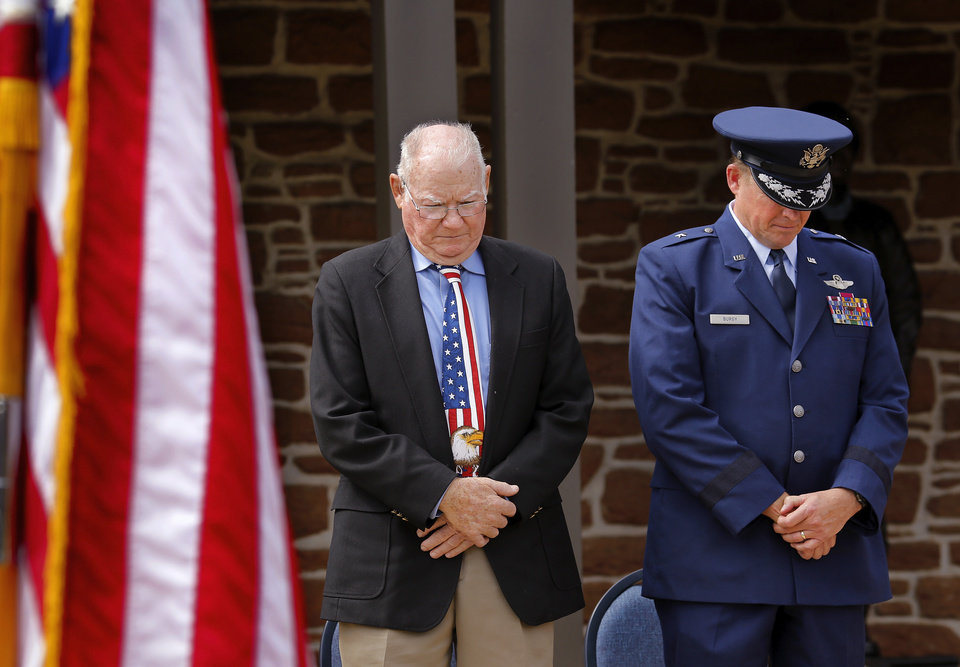 Photo - Preston Willoughby, an executive with the 45th Infantry Division Association, and a Korean War veteran, stands beside Brig. Gen. David Burgy, Chief of Staff, Joint Force Headquarters, Oklahoma Air National Guard. bow their heads during the benediction at the 45th Infantry Division Museum's Memorial Day Ceremony on Monday, May 30, 2016. Photo by Jim Beckel, The Oklahoman