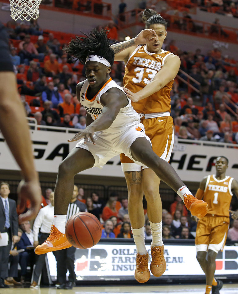 Photo - Oklahoma State's Isaac Likekele (13) loses the ball in front of Texas' Kamaka Hepa (33) during an NCAA basketball game between the Oklahoma State University Cowboys (OSU) and the Texas Longhorns at Gallagher-Iba Arena in Stillwater, Okla., Wednesday, Jan. 15, 2020. [Bryan Terry/The Oklahoman]